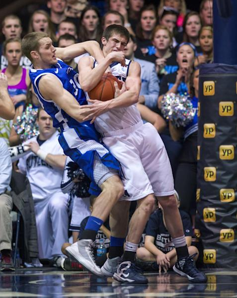 Saint Louis' Jake Barnett (30), left, and Butler's Andrew Smith (44) battle for a rebound during the first half of an NCAA college basketball game Friday, Feb. 22, 2013, in Indianapolis. (AP Photo/Doug McSchooler)