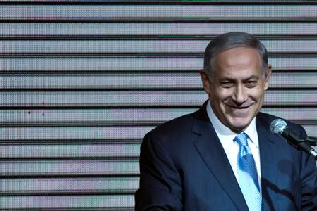 FILE PHOTO: Israeli Prime Minister Benjamin Netanyahu delivers a speech to supporters at party headquarters in Tel Aviv