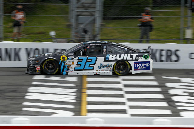 The No. 32 car of Corey LaJoie displays a Trump 2020 sticker as he competes during a NASCAR Truck Series auto race at Pocono Raceway, Saturday, June 27, 2020, in Long Pond, Pa. (AP Photo/Matt Slocum)