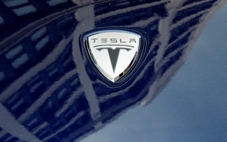 FILE PHOTO: A logo of Tesla Motors on an electric car model is seen outside a showroom in New York
