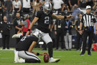 Las Vegas Raiders kicker Daniel Carlson (2) kicks a filed goal against the Miami Dolphins with seconds left during overtime of an NFL football game, Sunday, Sept. 26, 2021, in Las Vegas. (AP Photo/David Becker)