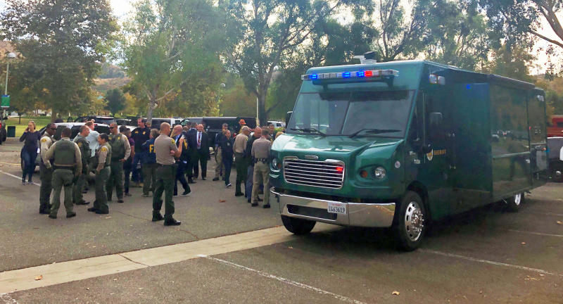 Law enforcement personnel gather outside Saugus High School following a shooting in Santa Clarita, Calif., Thursday, Nov. 14, 2019. (AP Photo/Stefanie Dazio)