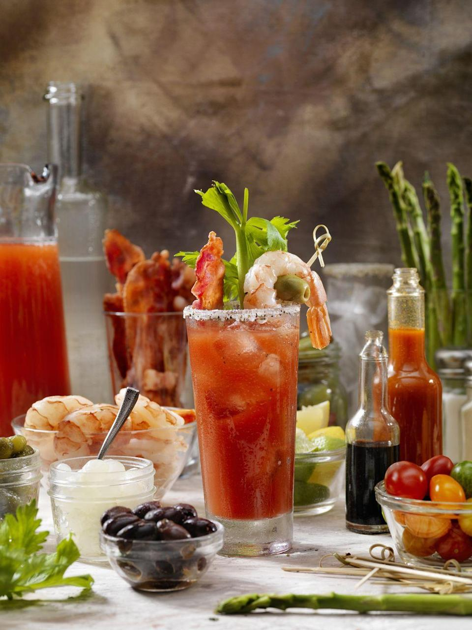 <p>While the dinner's roasting and baking, set out a Bloody Mary bar so guests can make their own brunch classic as they mingle and watch the parade. Bonus points for over-the-top garnishes like bacon, shrimp, and lobster. </p>
