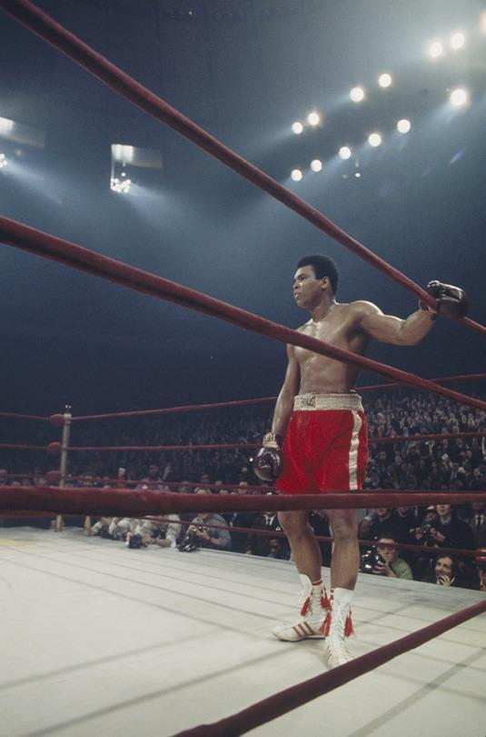 <p>Muhammad Ali stands in the corner of the ring during a match. (Photo by Focus on Sport/Getty Images)</p>