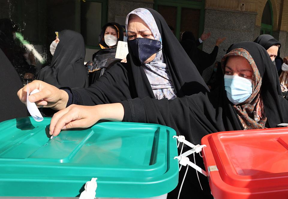 Iranian women cast their ballots for presidential election at a polling station in Tehran (AFP via Getty Images)