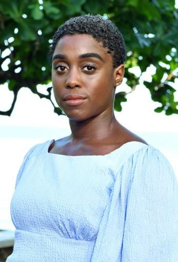 Actress Lashana Lynch in the grounds of Bond author Ian Fleming's home in Jamaica earlier this year. Felming died in 1964 but James Bond endures