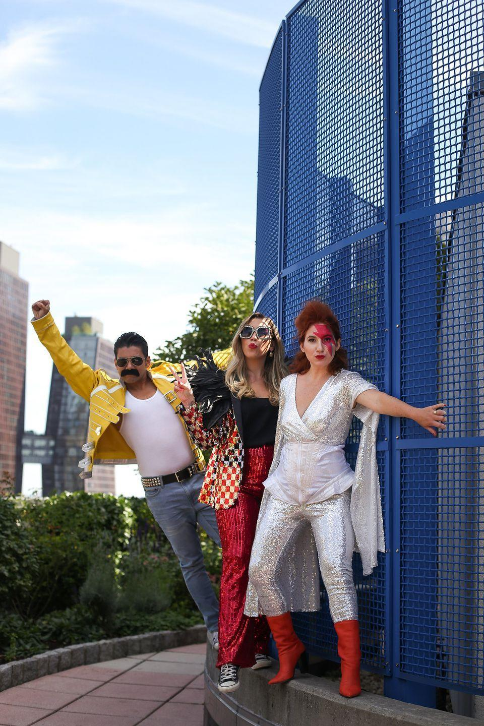 """<p>Pay homage to some of the most legendary rockstars of the decade—Elton John, David Bowie, and Freddie Mercury—with this group DIY Halloween costume. </p><p><strong>Find out more at <a href=""""https://livingaftermidnite.com/2019/10/group-halloween-costumes-that-will-win-you-best-dressed.html"""" rel=""""nofollow noopener"""" target=""""_blank"""" data-ylk=""""slk:Living After Midnite"""" class=""""link rapid-noclick-resp"""">Living After Midnite</a></strong>. </p>"""