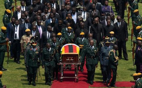 Robert Mugabe's coffin arrives for a state funeral at Harare's national stadium - Credit:  Ben Curtis/AP