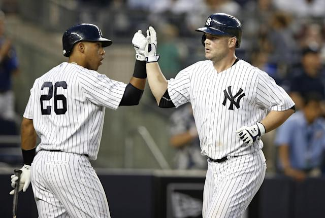 New York Yankees on-deck batter Yangervis Solarte, left, greets New York Yankees Brian McCann, right, after McCann hit a fourth-inning, two-run, home run off Toronto Blue Jays starting pitcher Mark Buehrle in a baseball game at Yankee Stadium in New York, Wednesday, June 18, 2014. (AP Photo/Kathy Willens)