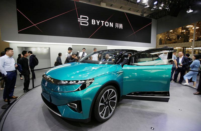 FILE PHOTO: A man checks a Byton Concept T car at the Auto China 2018 motor show in Beijing