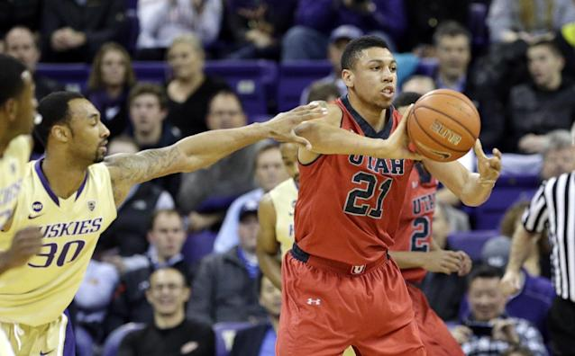 Utah's Jordan Loveridge (21) passes as Washington's Desmond Simmons defends during the first half of an NCAA college basketball game Wednesday, Jan. 8, 2014, in Seattle. (AP Photo/Elaine Thompson)