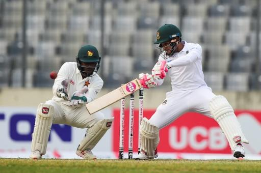 Bangladesh's Mushfiqur Rahim plays a shot as Zimbabwe's Regis Chakabva keeps wicket on the second day of their Test at the Sher-e-Bangla National Cricket Stadium in Dhaka