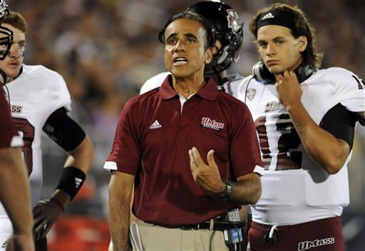 Massachusetts head coach Charley Molnar, center, reacts during an NCAA college football game against Connecticut at Rentschler Field in East Hartford, Conn., Thursday, Aug. 30, 2012. (AP Photo/Jessica Hill)