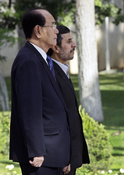Iranian President Mahmoud Ahmadinejad, right, and president of the Presidium of North Korea's Supreme People's Assembly Kim Yong-nam, listen to their national anthems during an official welcoming ceremony in Tehran, Iran, Saturday, Sept. 1, 2012. Kim Yong-nam attended the Nonaligned Movement summit in Tehran on Thursday and Friday. (AP Photo/Vahid Salemi)