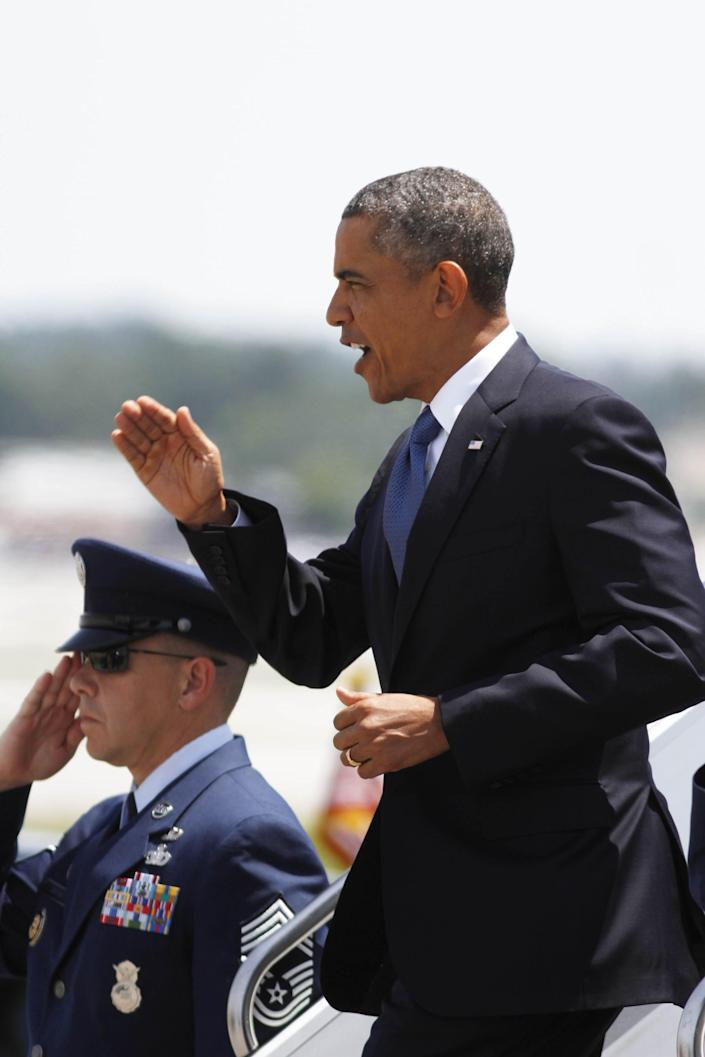 President Barack Obama departs Air Force One after landing at the TAC Air terminal at Lovell Field in Chattanooga, Tenn,, on Tuesday, July 30, 2013. President Obama visited the Amazon distribution center as part of his cross-country trip aimed at jump-starting his economic agenda. Photo by Dan Henry - The Chattanooga Times Free Press (AP Photo/Chattanooga Times Free Press, Dan Henry) THE DAILY CITIZEN OUT; NOOGA.COM OUT; CLEVELAND DAILY BANNER OUT; LOCAL INTERNET OUT