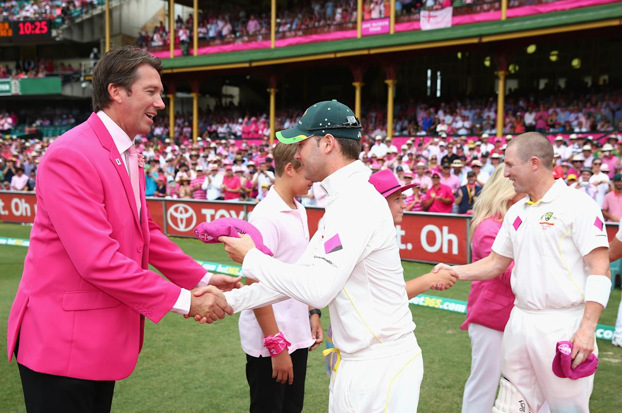 SYDNEY, AUSTRALIA - JANUARY 05:  Michael Clarke of Australia presents his Pink Cap to Glenn McGrath on Jane McGrath Day during day three of the Fifth Ashes Test match between Australia and England at Sydney Cricket Ground on January 5, 2014 in Sydney, Australia.  (Photo by Ryan Pierse/Getty Images)