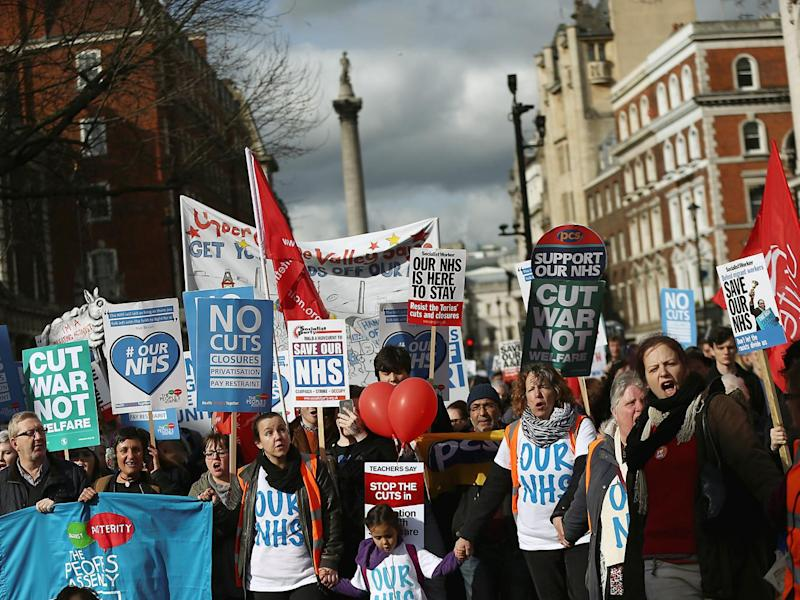 People take part in a demonstration to demand more funding for Britain's National Health Service (NHS), in London (Reuters)