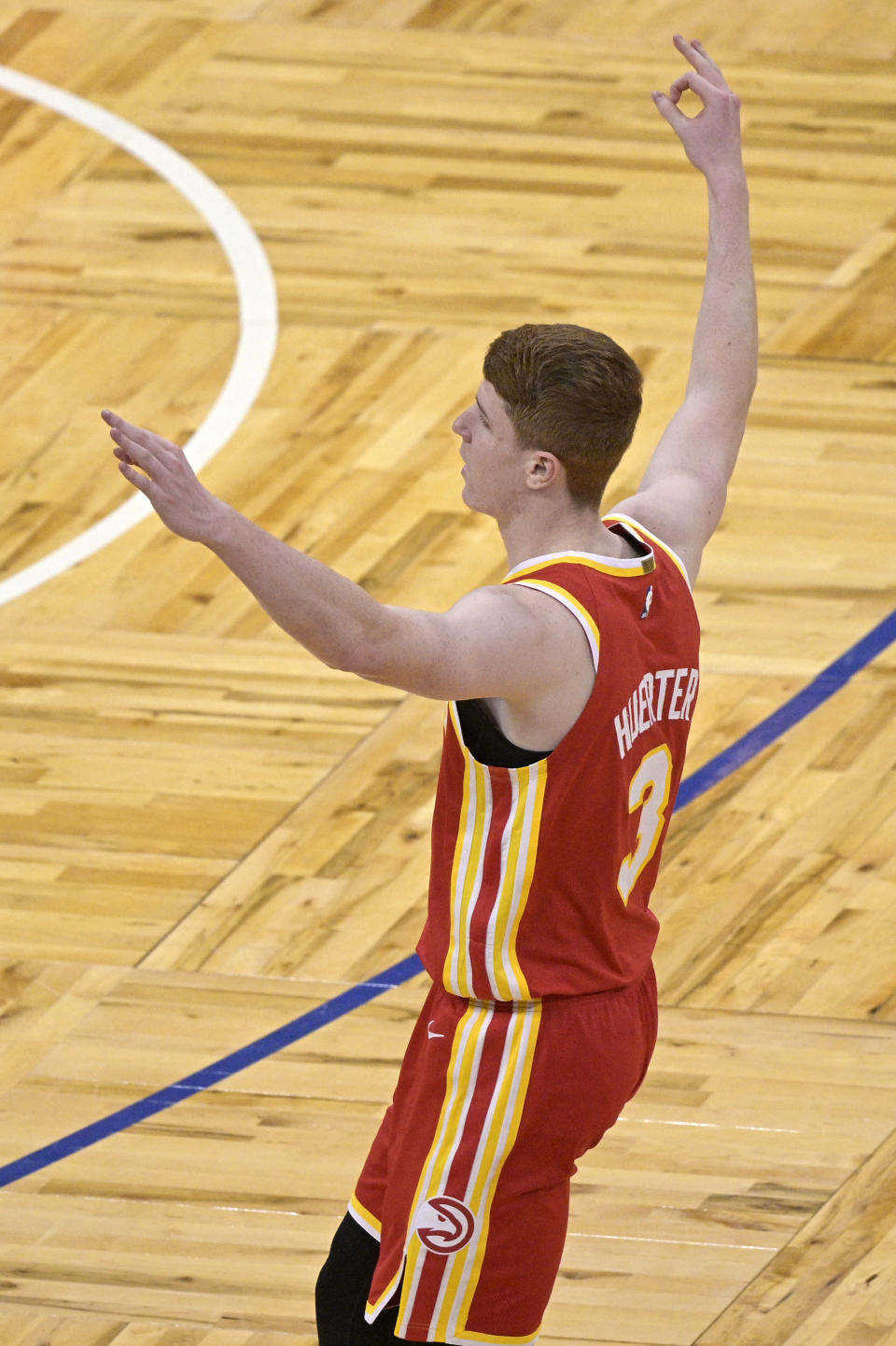 Atlanta Hawks guard Kevin Huerter celebrates after scoring a 3-pointer during the second half of the team's NBA basketball game against the Orlando Magic, Wednesday, March 3, 2021, in Orlando, Fla. (AP Photo/Phelan M. Ebenhack)