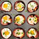 """<p>This low carb breakfast comes together in no time—seriously, you only need 20-ish minutes! If you like your eggs super runny, you might want to pull them from the oven a minute before you think they're ready. You'll need to let them rest for a bit in the muffin tin before taking them out (they'll be HOT), and during these few minutes, the eggs will continue to cook slightly.</p><p>Get the <a href=""""https://www.delish.com/uk/cooking/recipes/a29030029/ham-cheese-egg-cups-recipe/"""" rel=""""nofollow noopener"""" target=""""_blank"""" data-ylk=""""slk:Ham & Cheese Egg Cups"""" class=""""link rapid-noclick-resp"""">Ham & Cheese Egg Cups</a> recipe. </p>"""