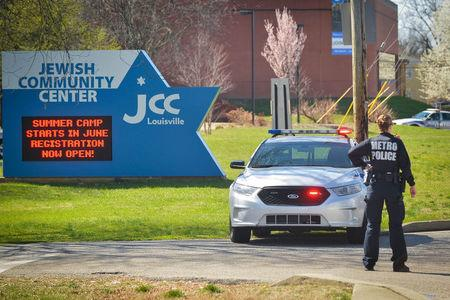 A police officer blocks an entrance as officials respond to a bomb threat at the Jewish Community Center in Louisville, Kentucky, U.S., March 8, 2017.  REUTERS / Bryan Woolston