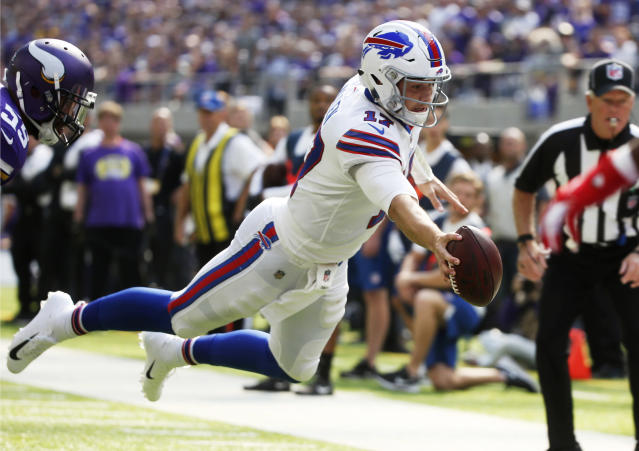 Buffalo Bills quarterback Josh Allen dives to the end zone during a 10-yard touchdown run against the Vikings. (AP)