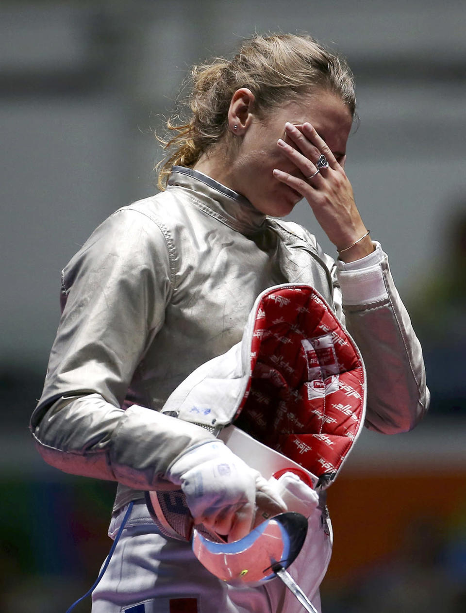 <p>Manon Brunet of France reacts after losing the women's sabre individual bronze medal bout on August 8, 2016. (REUTERS/Issei Kato) </p>