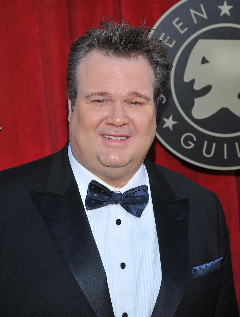 FILE - In this Jan. 29, 2012 file photo, Eric Stonestreet arrives on the red carpet at the 18th Annual Screen Actors Guild Awards in Los Angeles. Five stars of the hit ABC series sued 20th Century Fox Television on Tuesday July 24, 2012, claiming their contracts with the studio are illegal under California law and should be invalidated. (AP Photo/Vince Bucci, File)
