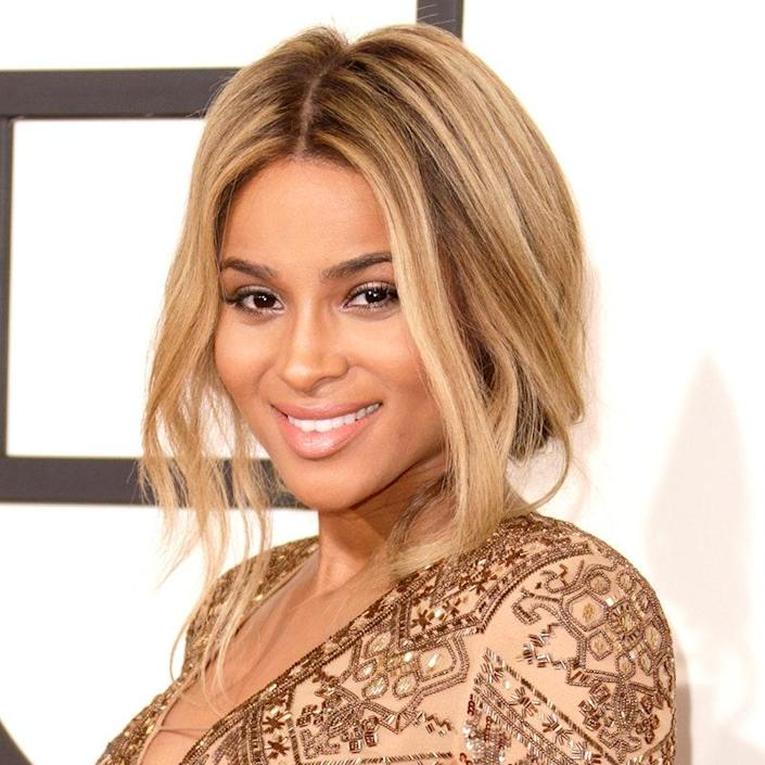 """Talk about a golden girl: Ciara's stunning honey-ish hue looks """"natural and soft,"""" says colorist <a href=""""https://www.instagram.com/ritahazan/"""" rel=""""nofollow noopener"""" target=""""_blank"""" data-ylk=""""slk:Rita Hazan"""" class=""""link rapid-noclick-resp"""">Rita Hazan</a>. To steal it for yourself, leave your roots dark (or ask your colorist to give you a dark brown base), then pile on several layers of highlights. """"You want some of them to be golden beige and some slightly lighter ones mixed in on top,"""" says colorist Marie Robinson. """"Keeping the brown roots next to your skin ensures that you don't become washed out."""""""