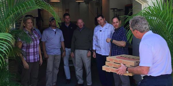 Former President George W. Bush delivers pizza to Secret Service