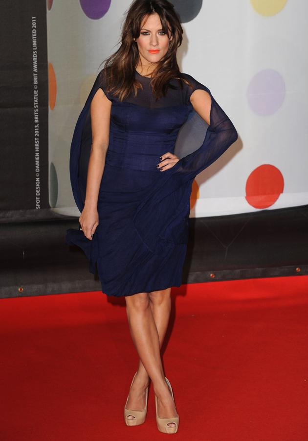 BRIT Awards 2013: Caroline Flack added a colour-pop twist to her navy outfit with bright coral lips ©Getty
