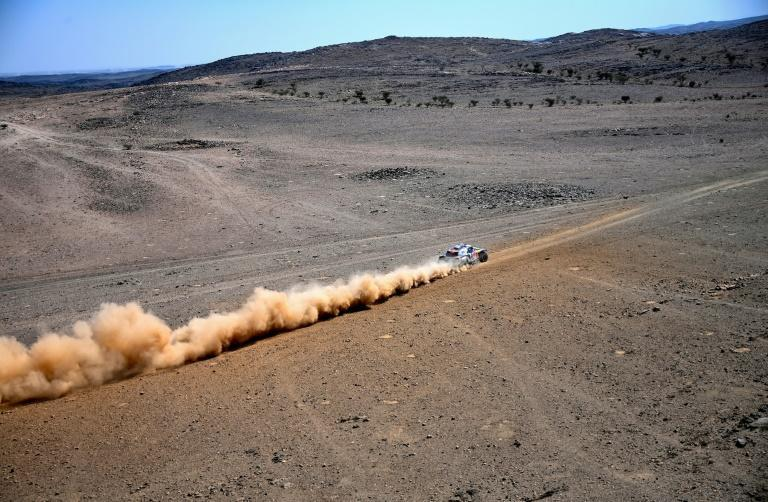Defending champion Carlos Sainz won the first stage of the Dakar Rally on Sunday