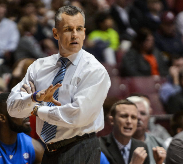 Florida coach Billy Donovan signals to his players during an NCAA college basketball game against Alabama on Thursday, Jan. 23, 2014, at Coleman Coliseum in Tuscaloosa, Ala. (AP Photo/AL.com, Vasha Hunt)