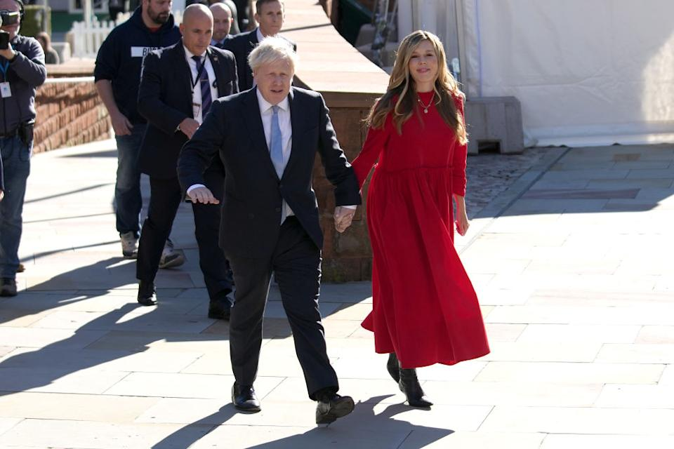 Carrie Johnson used her wardrobe at the Conservative Party conference to shine a light on British independent brands, pictured with husband Boris Johnson. (Getty Images)