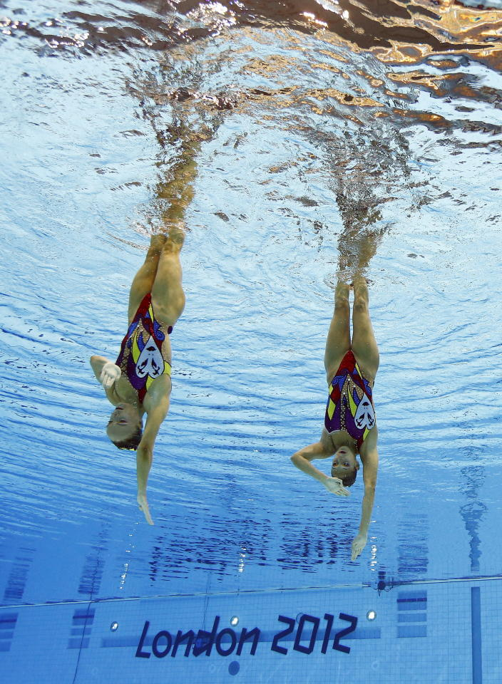 Marie-Pier Boudreau Gagnon and Elise Marcotte of Canada compete during women's duet synchronized swimming preliminary round at the Aquatics Centre in the Olympic Park during the 2012 Summer Olympics in London, Monday, Aug. 6, 2012. (AP Photo/Mark J. Terrill)