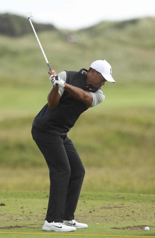 Tiger Woods of the United States hits a shot at the practice ground ahead of the start of the British Open golf championships at Royal Portrush in Northern Ireland, Tuesday, July 16, 2019. The British Open starts Thursday. (AP Photo/Jon Super)