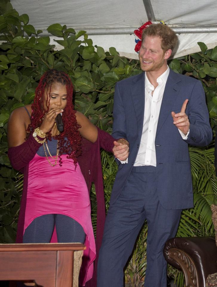 <p>Prince Harry dances with soca singer Claudette Peters during a reception hosted by Prime Minister of Antigua.</p>