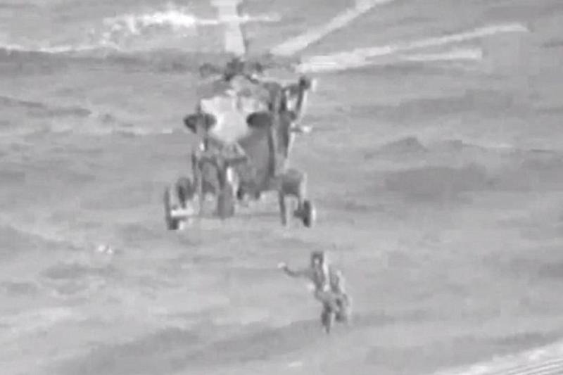 The woman and children are rescued by helicopter