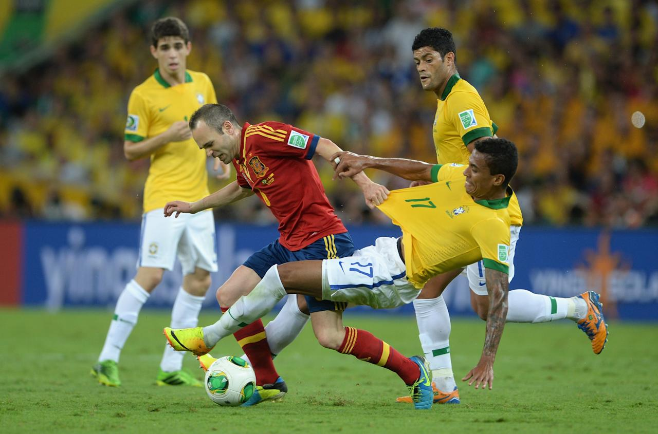 RIO DE JANEIRO, BRAZIL - JUNE 30: Andres Iniesta of Spain and Luiz Gustavo of Brazil compete during the FIFA Confederations Cup Brazil 2013 Final match between Brazil and Spain at Maracana on June 30, 2013 in Rio de Janeiro, Brazil. (Photo by Michael Regan/Getty Images)