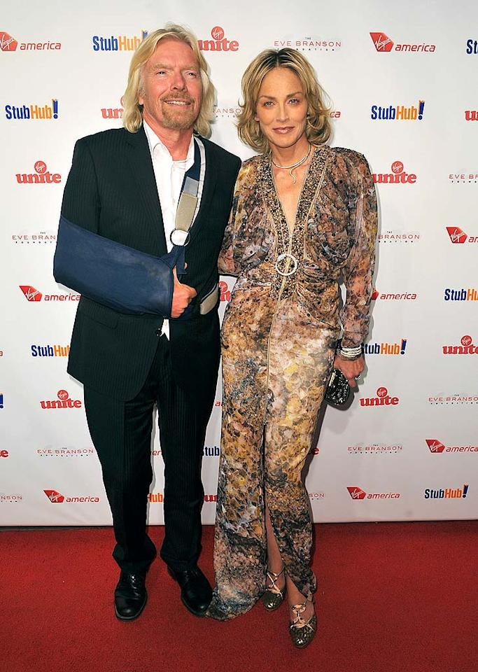 """Billionaire businessman Richard Branson, who hosted the event with his mother, Eve, arrived with a sling on one arm and Sharon Stone on the other. Alberto E. Rodriguez/<a href=""""http://www.gettyimages.com/"""" target=""""new"""">GettyImages.com</a> - October 26, 2009"""