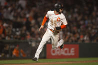 San Francisco Giants' Steven Duggar rounds third and heads for home on an RBI single by Tommy LaStella against the San Diego Padres during the fourth inning of a baseball game Tuesday, Sept. 14, 2021, in San Francisco. (AP Photo/D. Ross Cameron)