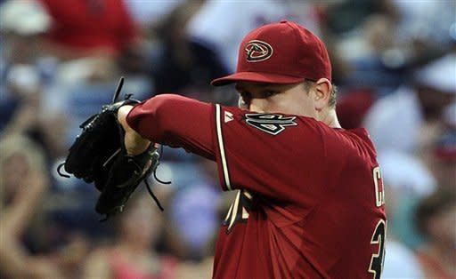 Arizona Diamondbacks pitcher Trevor Cahill wipes his face after loading the bases during the fifth inning of a baseball game against the Atlanta Braves, Wednesday, June 27, 2012, in Atlanta. (AP Photo/John Amis)