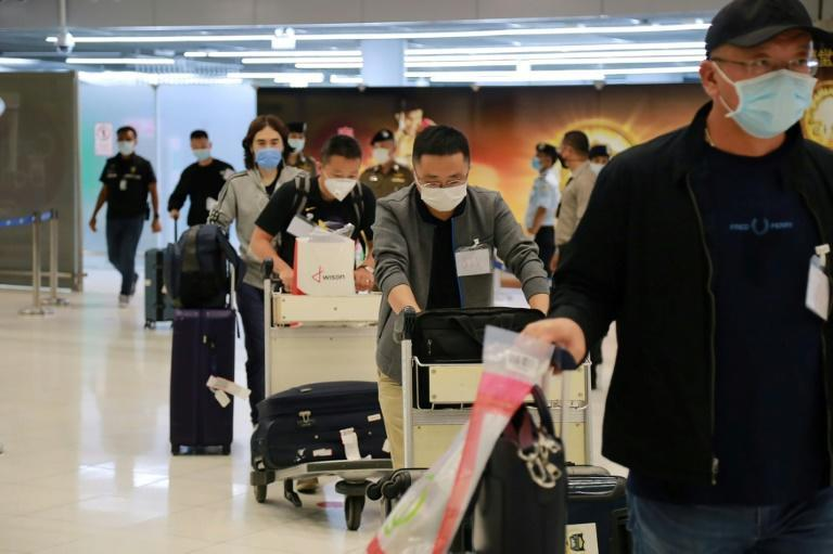 39 Chinese tourists flew into Bangkok's Suvarnabhumi Airport Tuesday evening from Shanghai to a welcome from staff in full protective equipment