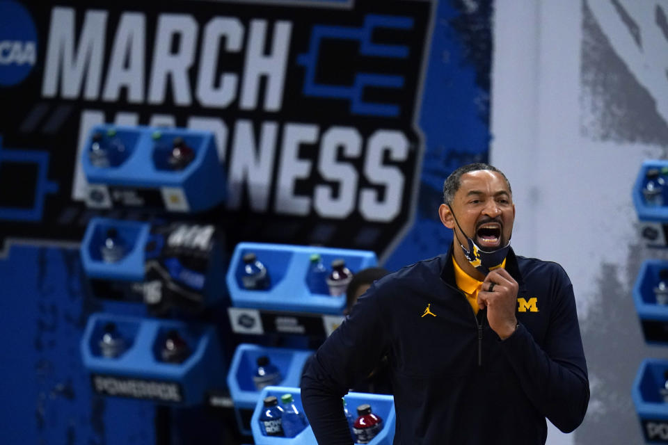 Michigan head coach Juwan Howard directs his team during the first half of a Sweet 16 game against Florida State in the NCAA men's college basketball tournament at Bankers Life Fieldhouse, Sunday, March 28, 2021, in Indianapolis. (AP Photo/Jeff Roberson)