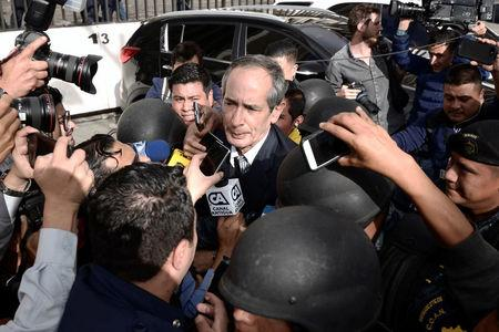 Former Guatemalan President Alvaro Colom arrives to court escorted by policemen after being detained as part of a local corruption investigation, in Guatemala City, Guatemala February 13, 2018. REUTERS/Fabricio Alonzo