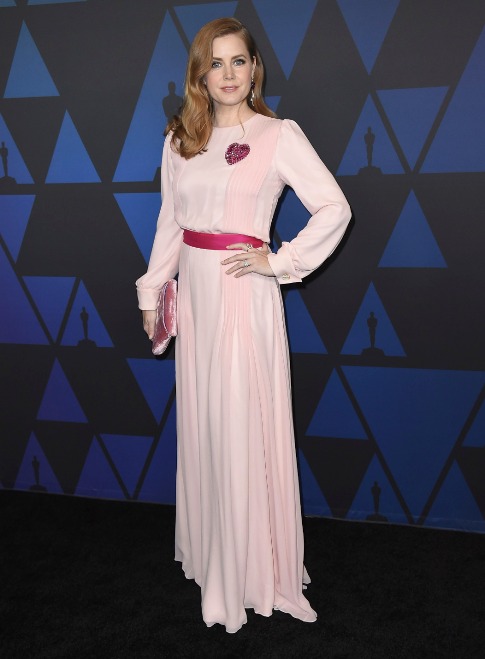 <p>The actor wore a blush pink gown by Schiaparelli at the 10th annual Governors Awards at the Ray Dolby Ballroom in Los Angeles. She also carried the Tyler Ellis Lee Pouchet. [Photo:<em> Rex]</em> </p>