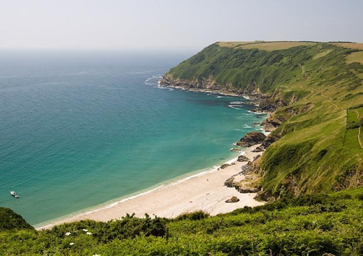 <p>Lantic Bay beach is definitely one of those that, at first, will have your friends asking, 'Why did you bring us here again?' That is, until they crest the hill and see this sparkling crest of sandy beach beneath towering green cliffs. The unspoilt environment brings an immediate sense of peace and relaxation, and is worth the 20-minute hike to get there. </p><p><strong>Don't Miss</strong>: The chance to spend a full day exploring once you've arrived - pack plenty of essentials for a long, leisurely afternoon.</p>