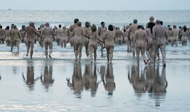 People take part in the North East Skinny Dip at Druridge Bay in Nothumberland.