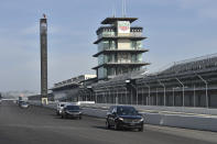 This photo provided by Indianapolis Motor Speedway shows the funeral procession for Aldo Andretti, twin brother of Mario Andretti, taking a lap around the track before funeral services Wednesday, Jan. 13, 2021. Mario feels the same pain as so many others these days. His wife died two years ago, long before the pandemic. And his beloved nephew lost a brutal battle with colon cancer. But then COVID-19 claimed his twin brother Aldo and one of the greatest racers of all time is not immune from the loneliness and depression sweeping the world. (Chris Owens/Courtesy IMS Photo via AP)
