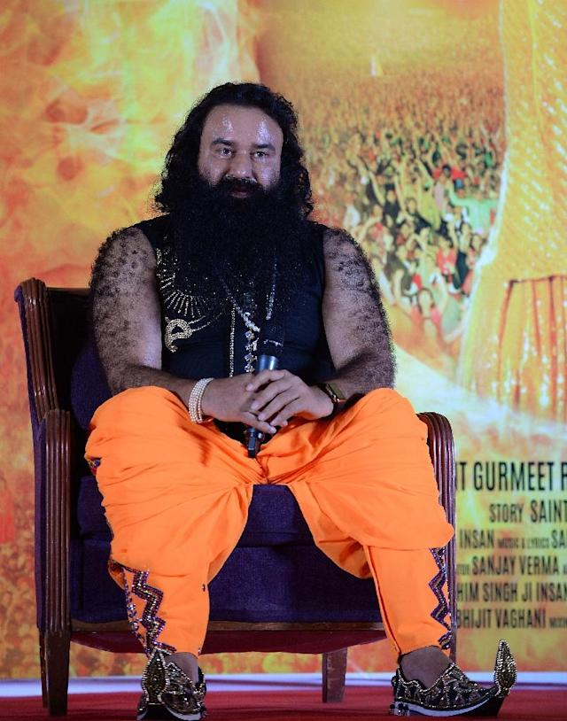 """Followers of the flamboyant Ram Rahim Singh, who is known as the """"guru in bling"""" because of his penchant for bejewelled costumes and customised superbikes, continue to insist upon his innocence (AFP Photo/PUNIT PARANJPE)"""
