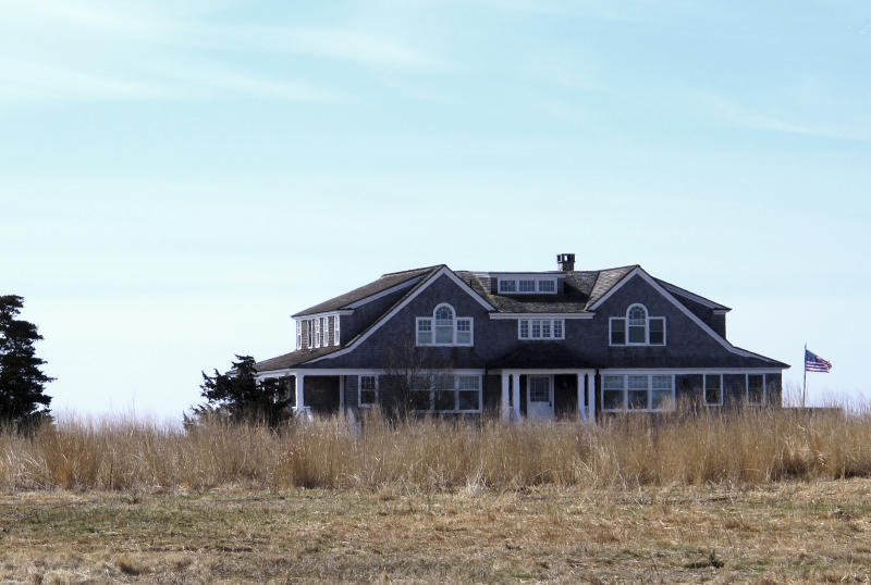 In this April 2, 2019 photo, a multimillion-dollar home sits on a peninsula in Old Saybrook, Conn. The home is among more than 900 structures on the East Coast that would become newly eligible for federal disaster aid, under a proposed remapping of coastal protection zones by the U.S. Fish & Wildlife Service (AP Photo/Dave Collins)